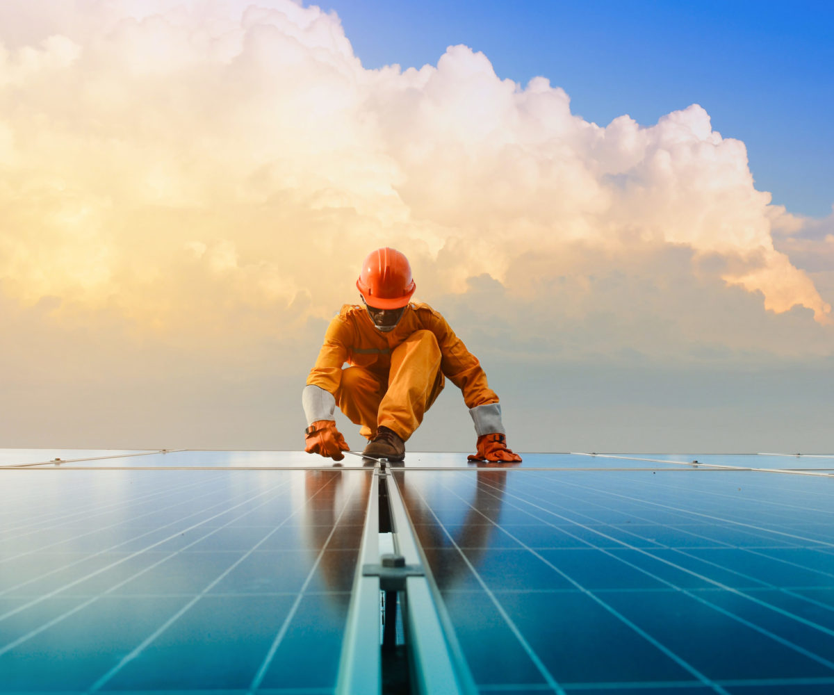 A,Man,Working,At,Solar,Power,Station